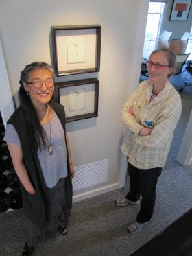 Kyoung Ae Cho and Lynden executive director Polly Morris flank two of the artist's Tree series.