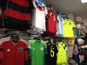 Colorful World Cup replica team jerseys line the walls at Stefan's Soccer