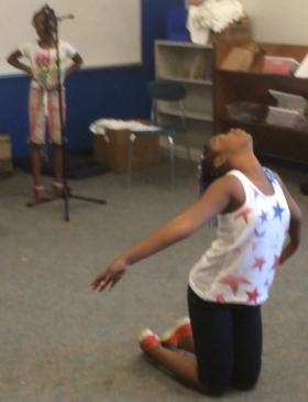Camp attendee practices praise dance for Project Ujima talent show.
