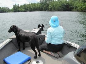 Judith Bloom and Belle assume their loon monitoring positions.
