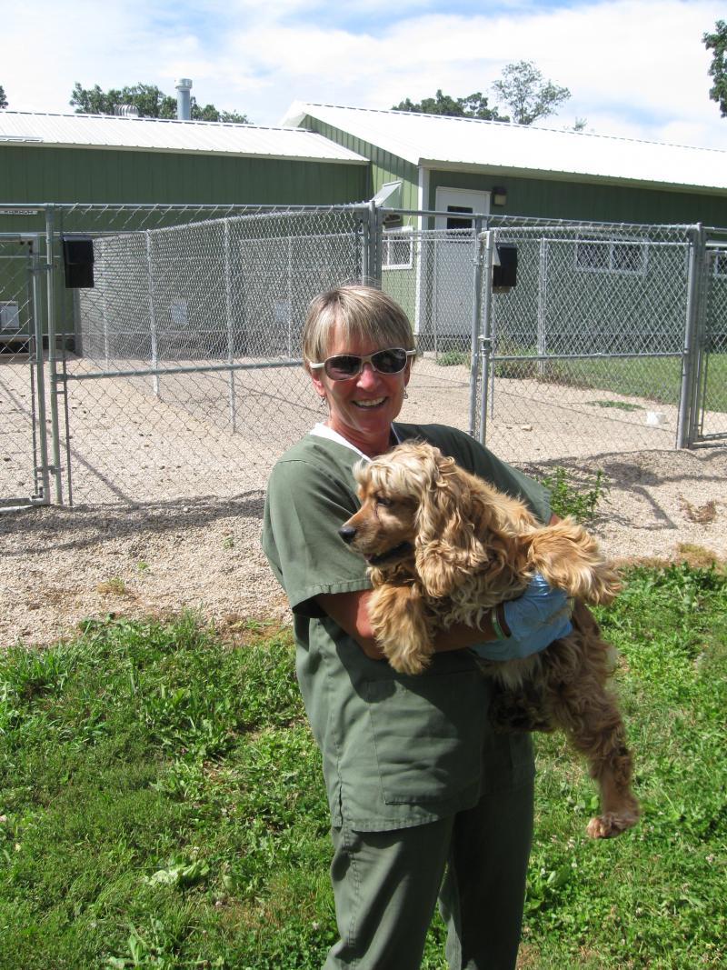 Humane Society Worker Jill DeGrave Carries Dog
