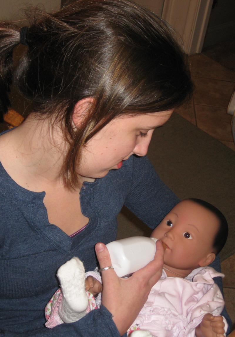 Hallie feeding RealCare® Baby