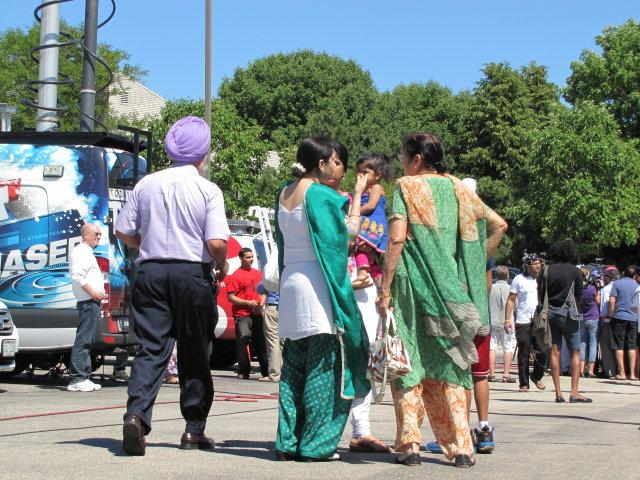 Family members and friends wait for news and answers near the Sikh Temple in Oak Creek.