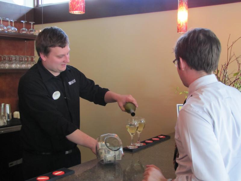 Zen on 7's Joe pouring wine