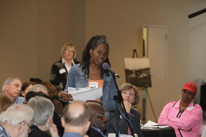 Attendees share their table's ideas.