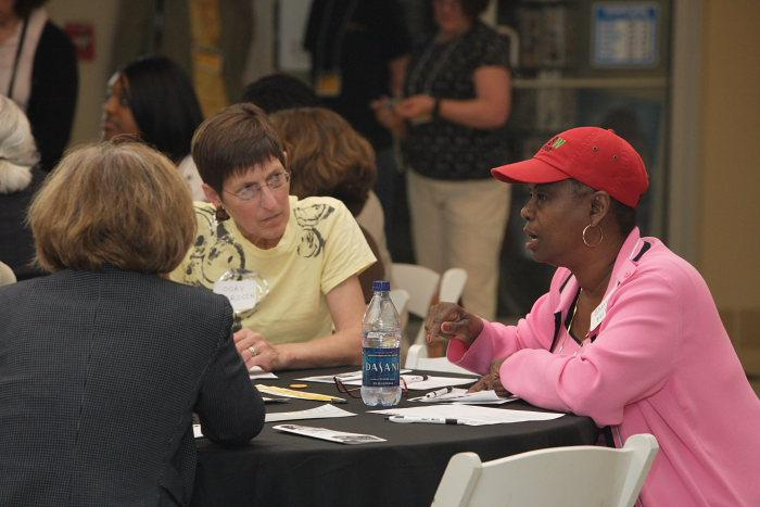Attendees discuss the issues.