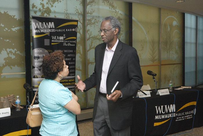 Attendee talks with Howard Fuller.