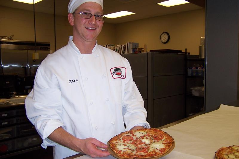 Corporate Chef Dax Schaefer's job is to make the pizzas at the Palermo's plant, so they can be taste tested.