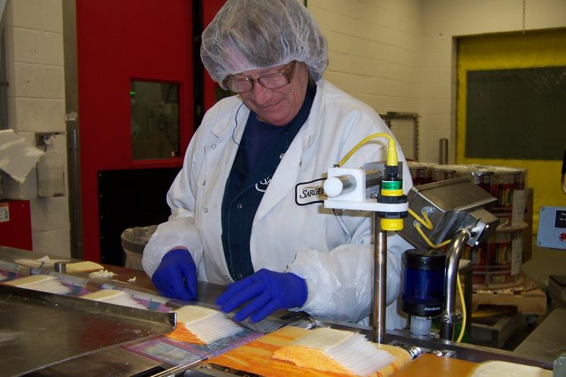 Employee Counts Cheese at the Sargento Plant