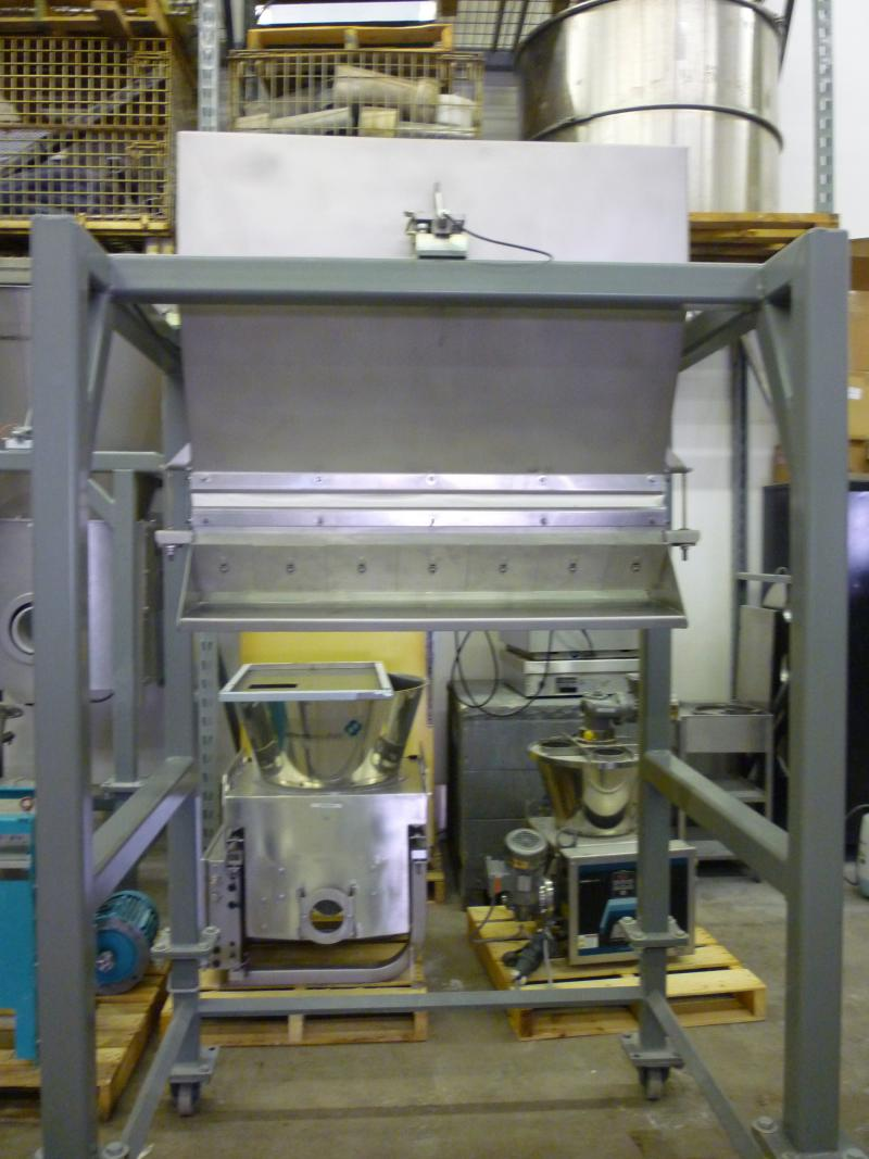 This machine made by Schenck AccuRate can be used by food manufacturers to, for example, evenly distribute toppings on a pizza.