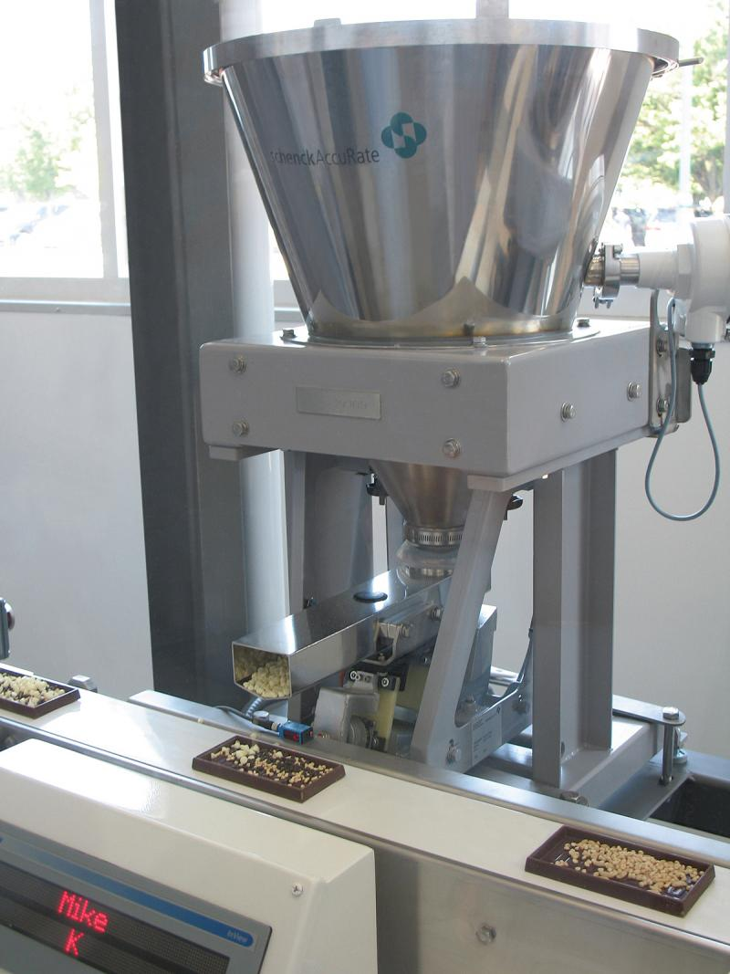 The Schenck AccuRate feeders are being used to help Hershey Chocolate World visitors to add the ingredients they want in their customized chocolate bar.