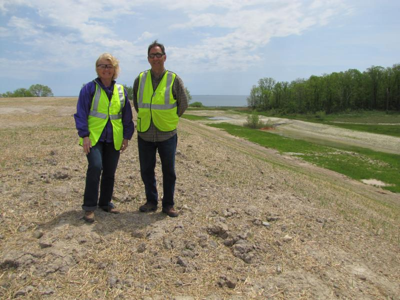 DuPont site:  Kathy Huibregtse & Paul Sklar atop clay mountain. The soil will be used to top of the industrially-worn terrain
