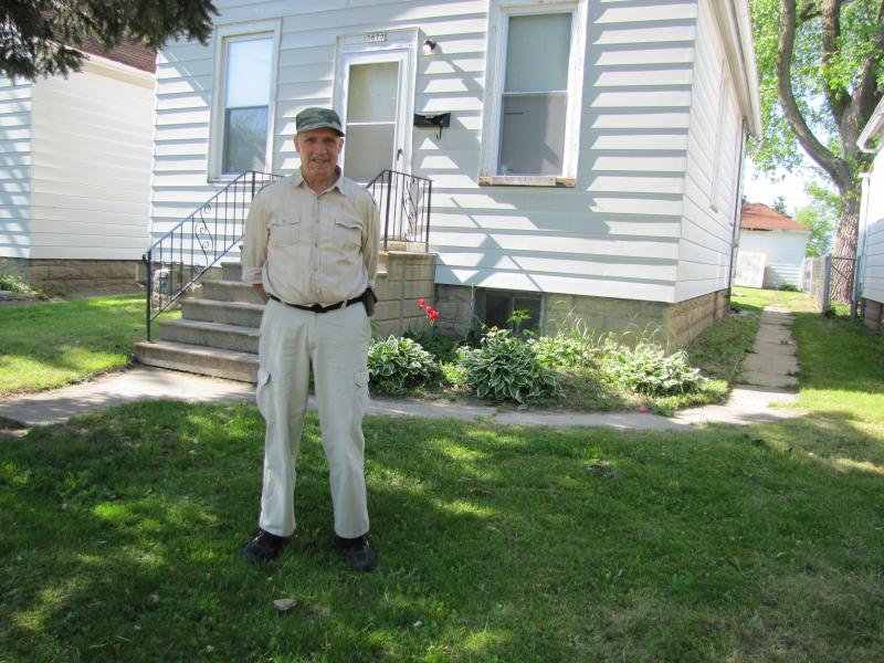 Moses grew up in Carrollville.  He stands in front of his first home.