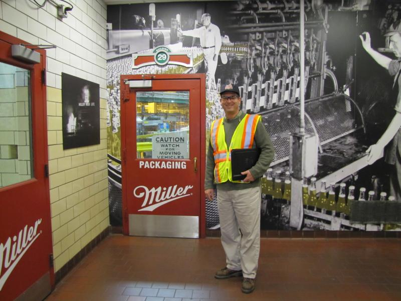 Plant Manager Andrew K. Moschea.  Some employee entrances feature historical images of the long-ago Miller Brewery.