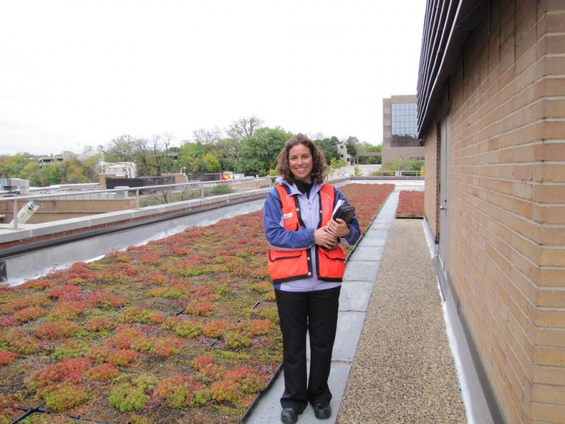 Joan Meyer  Environmental Engineer surveys the green roof at Milwaukee plant.