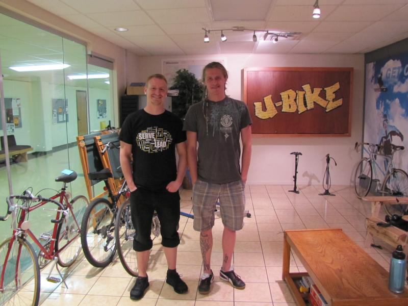 U-Bike's  coordinator Kyle Schulz (left) with fellow bike mechanic Dalton Schiebel