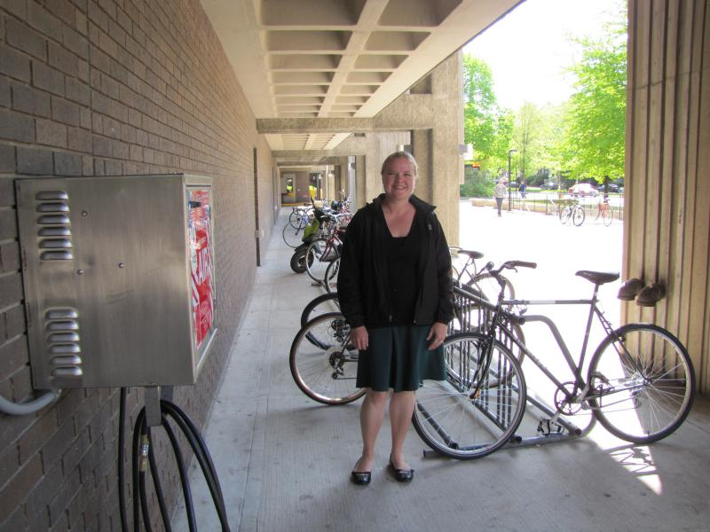 Sustainability is her mission  UWM's Kate Nelson next to a section of the school's 1300 linear feet of bike racks as well as its new air compressor.