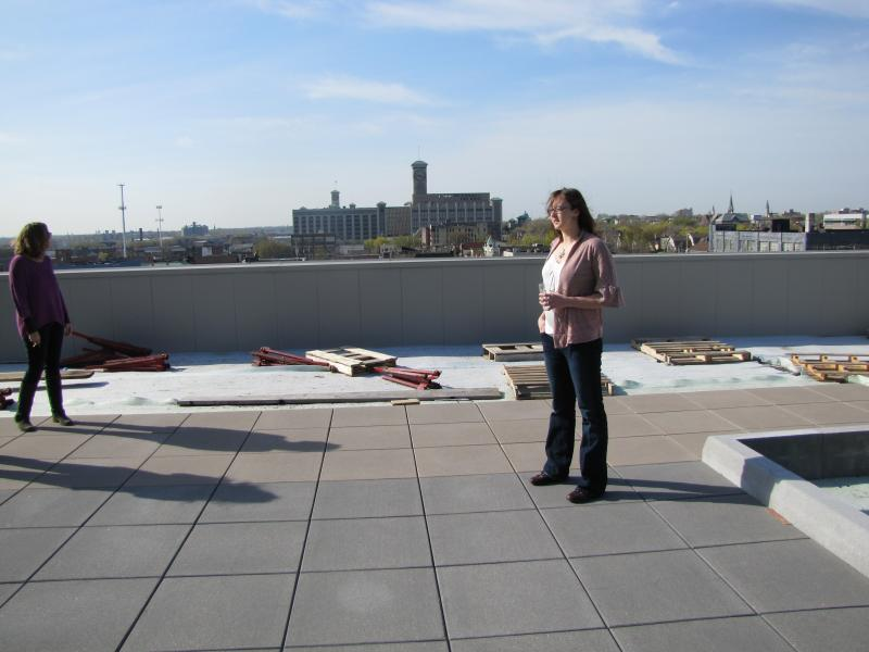 Allen Bradley clock tower inspired name of Clock Shadow Building. Stephanie Calloway (right) surveys the rooftop in its early stages.