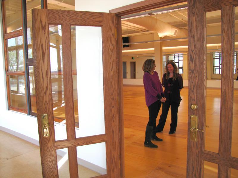 Developer Juli Kaufmann (left) and Jayne Ader (CORE/El Centro)  inside Core/El Centro's studio space. Repurposed doors and windows allow natural light.