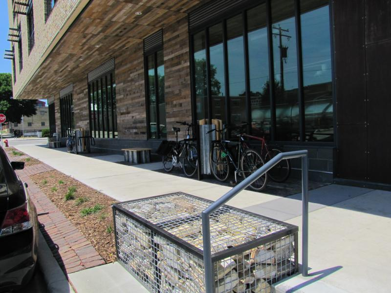 Outside the building bicycle racks and sidewalk are punctuated by caged rocks - called gabions - are left over brick salvaged from those used on the facade.