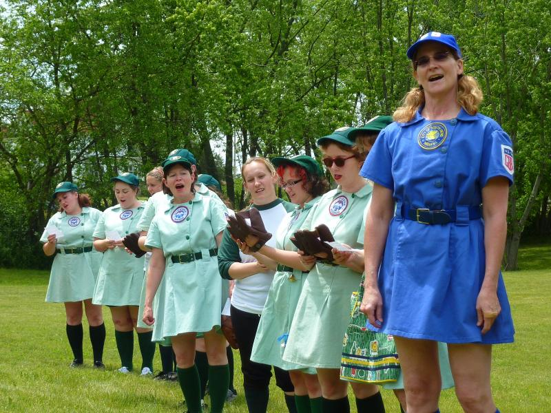 """The living history players sing the original league's """"Victory Song"""" at the start of the game."""