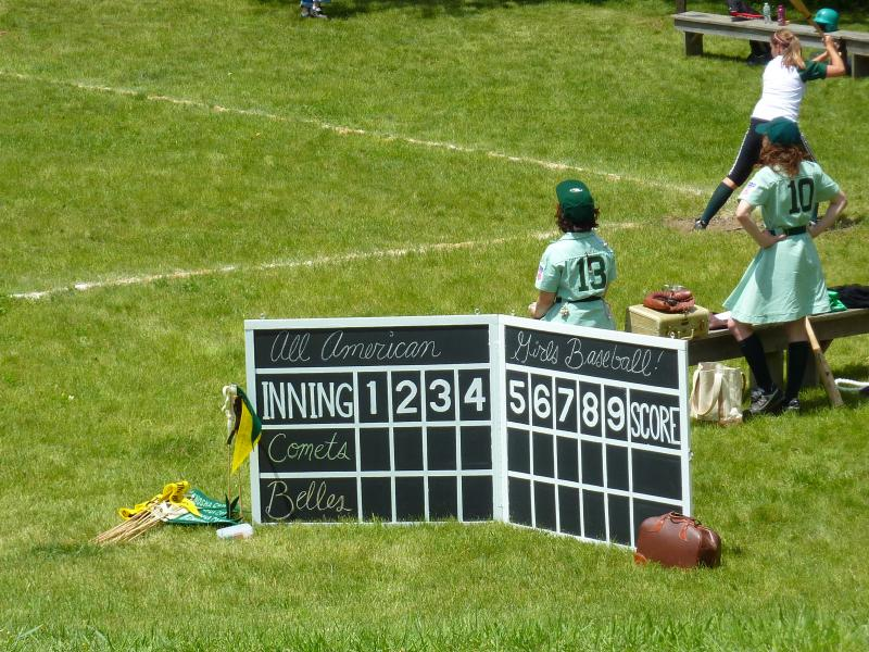 Scoreboard: An old-fashioned board helps the crowd keep score.