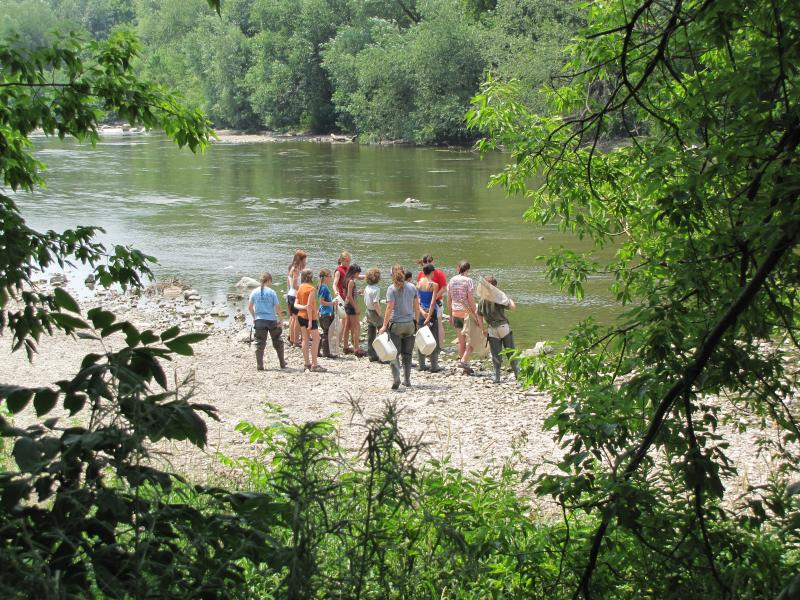 Young summer scientists on the river.