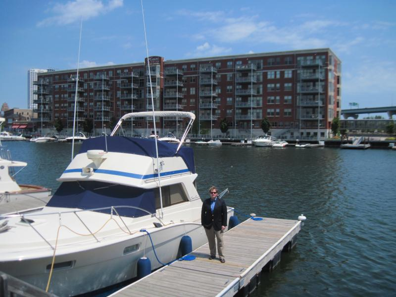 Peter Hansen stands next to a boat docked at the Hansen Marina.