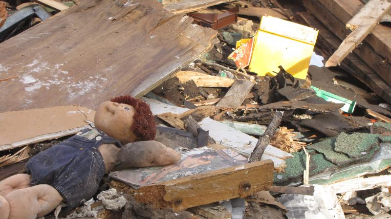 Doll in debris