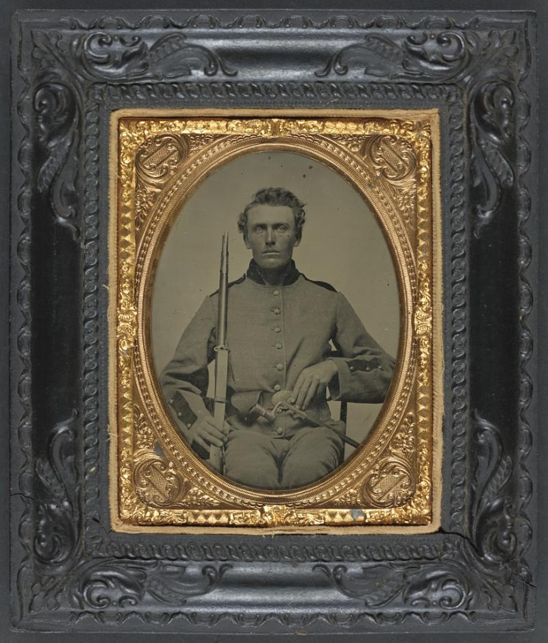 Unidentified soldier of 8th Wisconsin Infantry Regiment, with musket, bayonet, and scabbard.