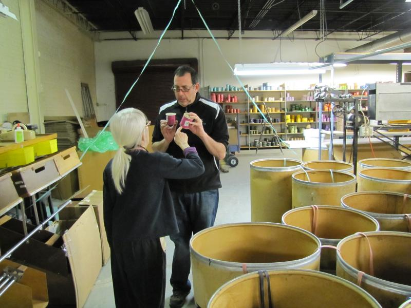 Ribbon maker and owner talk over an order that's about to be shipped out.