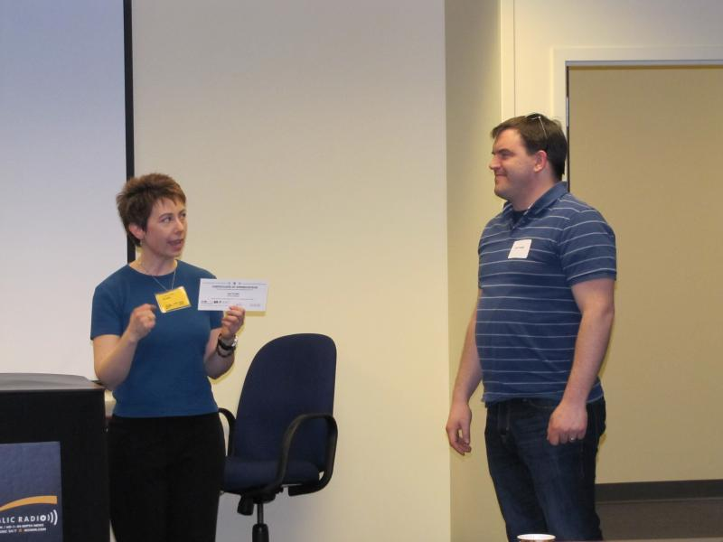 Cynthia presents a certificate to Joel Trudell