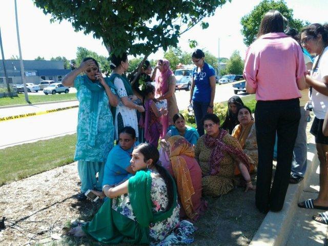 Worried people near temple.