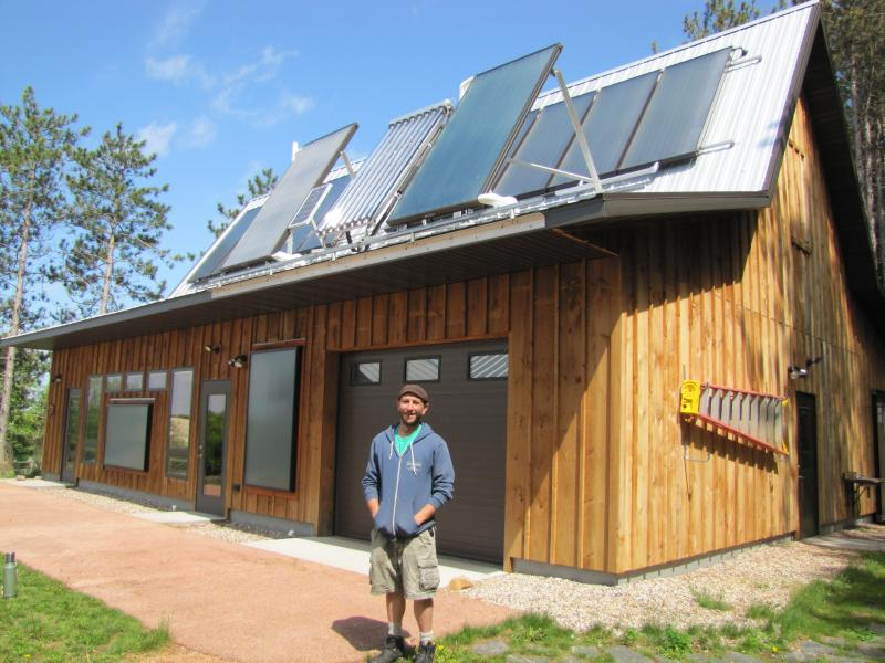 Renewable energy business owner, Josh Stolzenburg in front of an MREA classroom