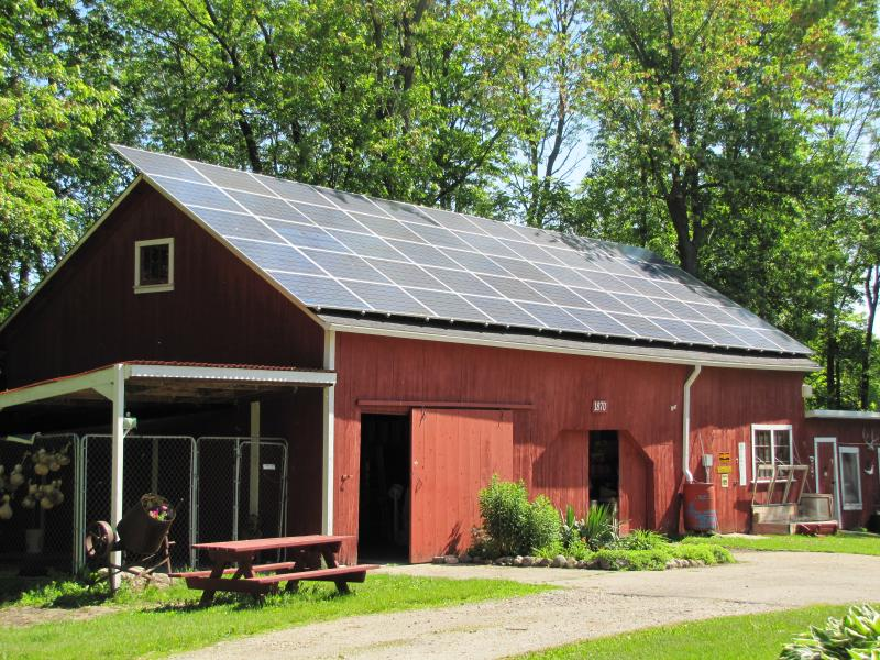 Fifty-five solar panels blanket 1870 barn.
