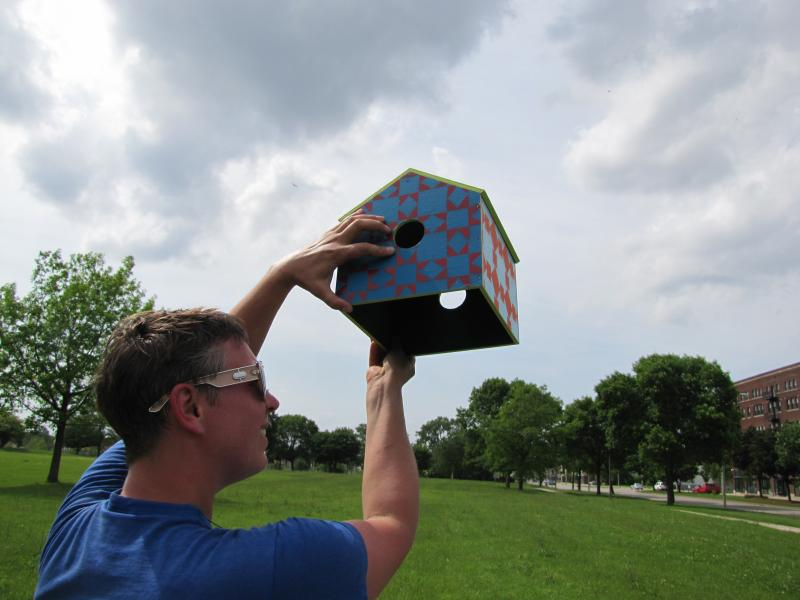 Peck painted birdhouses' insides color she observes on boarded-up homes around town.