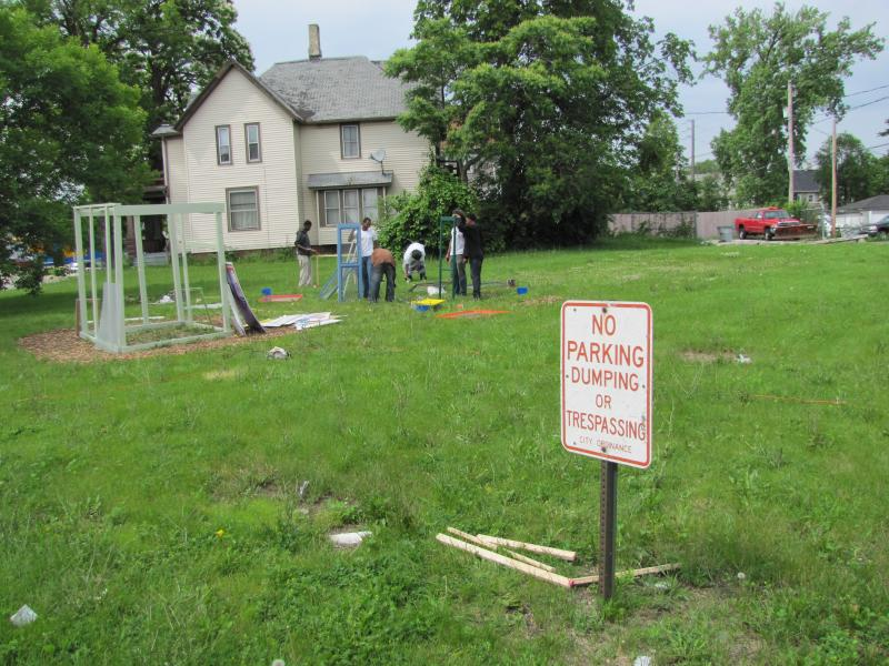 "Artist George Jones ""Green Urban Flow Space"" in progress with the assistance of Milwaukee Community Conservation Corps."