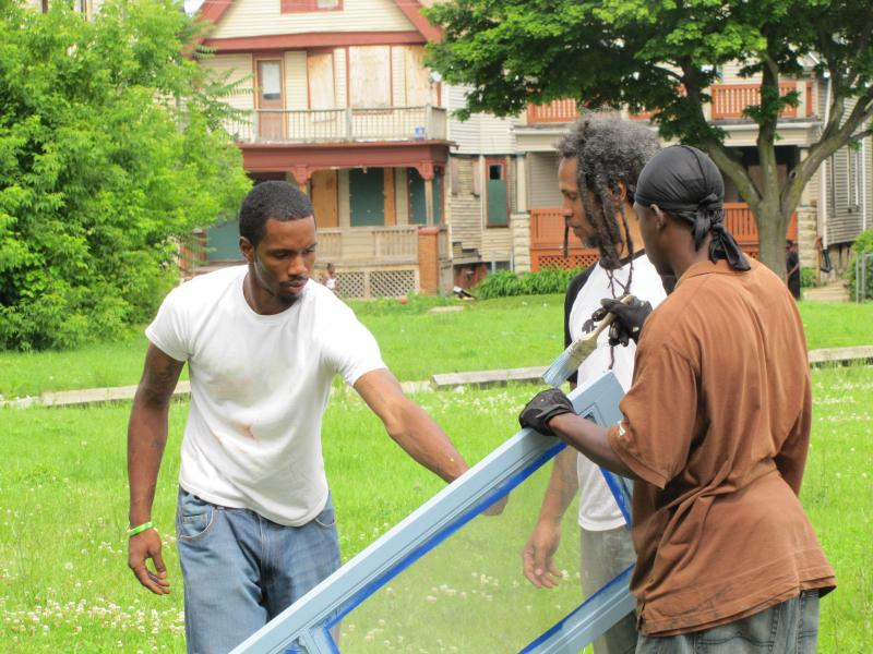 Corps member Christian Forteaberry (left) is inspired to borrow Jones' design to build greenhouse for his mom.