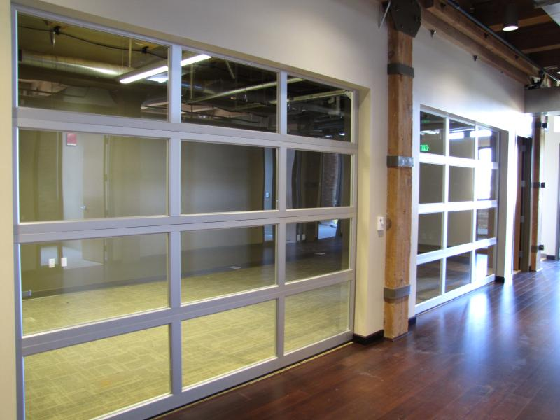 One office space incorporates working garage doors.