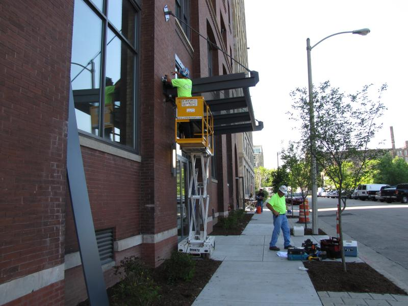 Workers add finishing touches outside as tenants move into Global Water Center.