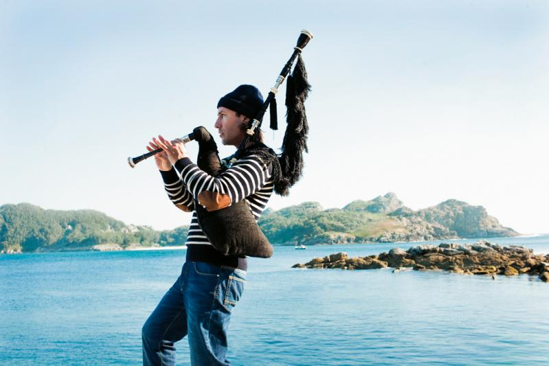 Carlos Núñez, playing his pipes in the Cies Islands in Galicia, Spain.