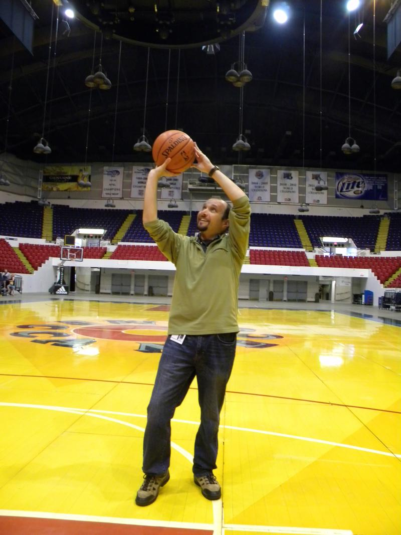 Lake Effect's Mitch Teich takes a shot on the vintage MECCA basketball court floor.