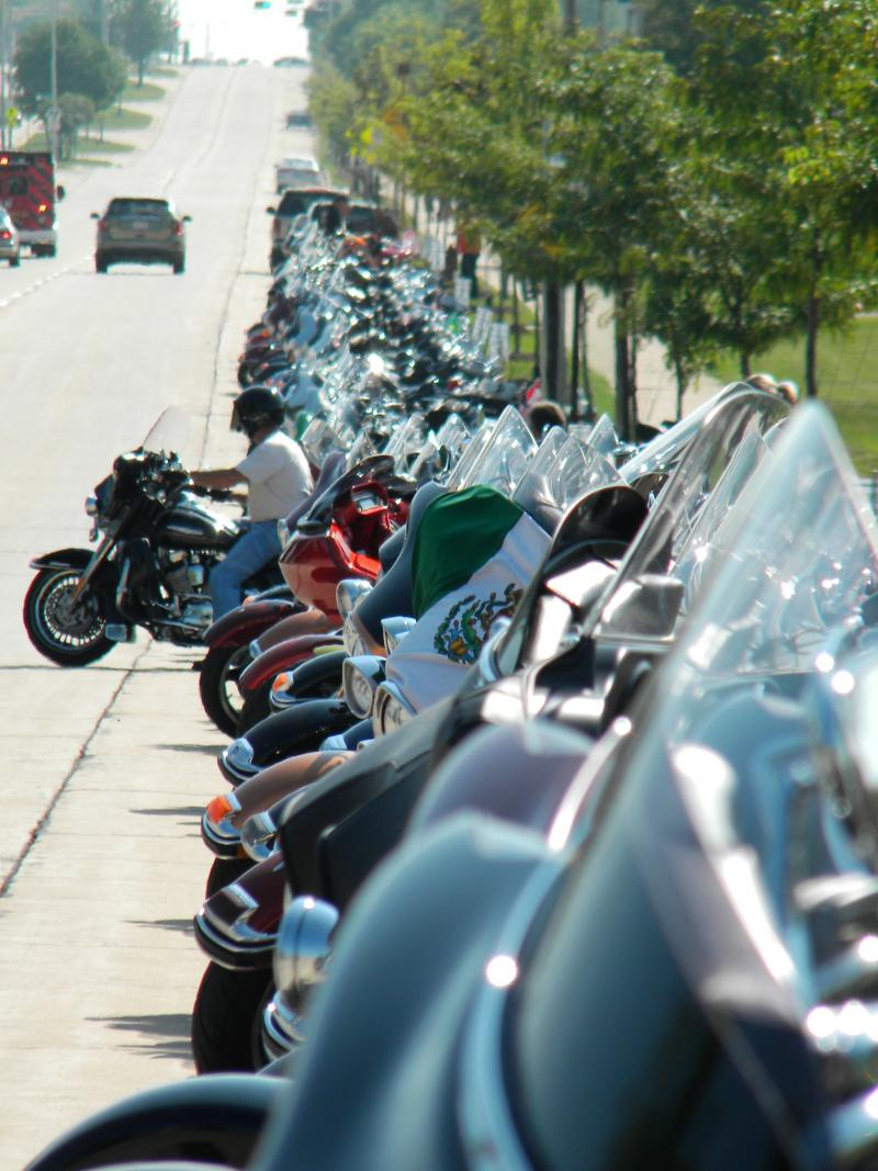 Harley-Davidsons line the street near the House of Harley at 62nd & Layton.