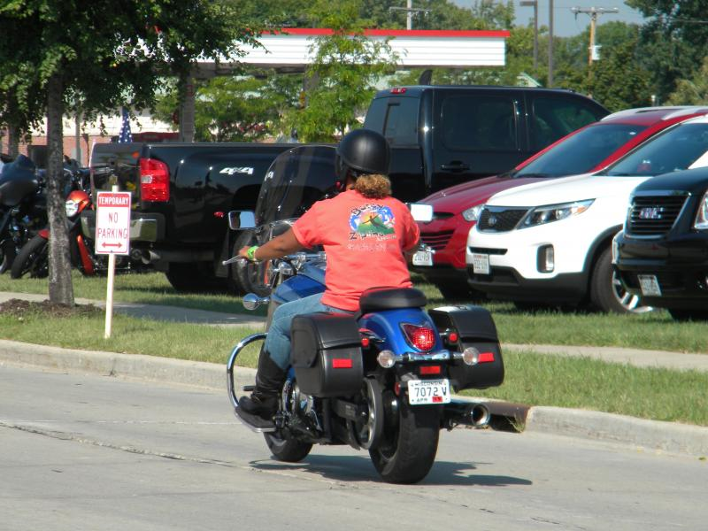 A rider cruises Milwaukee streets.