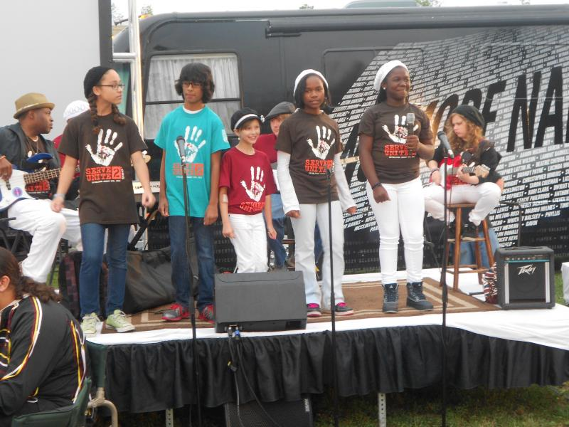 Children from Skai Academy performed during Monday's vigil.