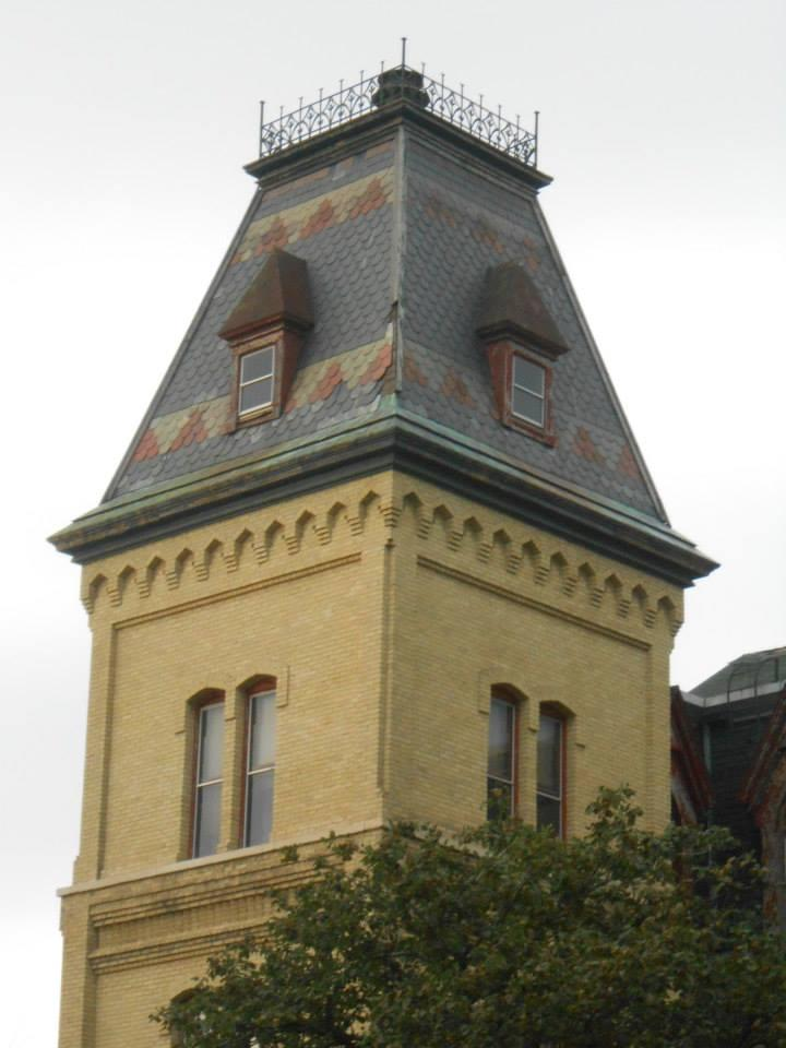 A squared-off turret of the Old Veterans Home without the protective mesh.