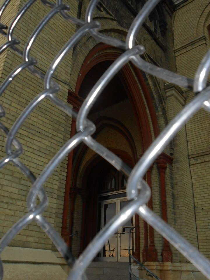 The gothic arches are found on the doorways and windows of the building.