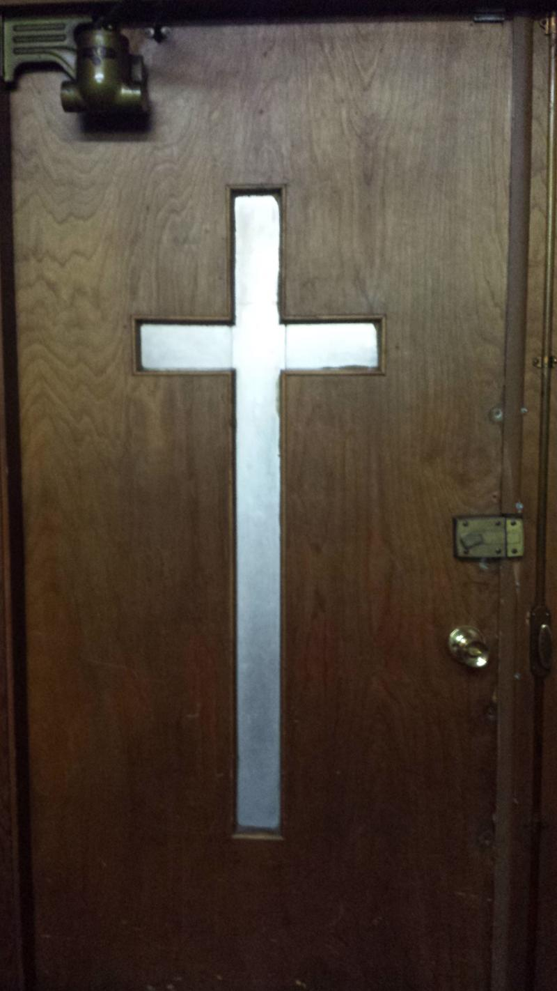 A cross adorns the door at the Masonic Wonders' rehearsal space at the Newborn Christ Baptist Church at 17th and Center