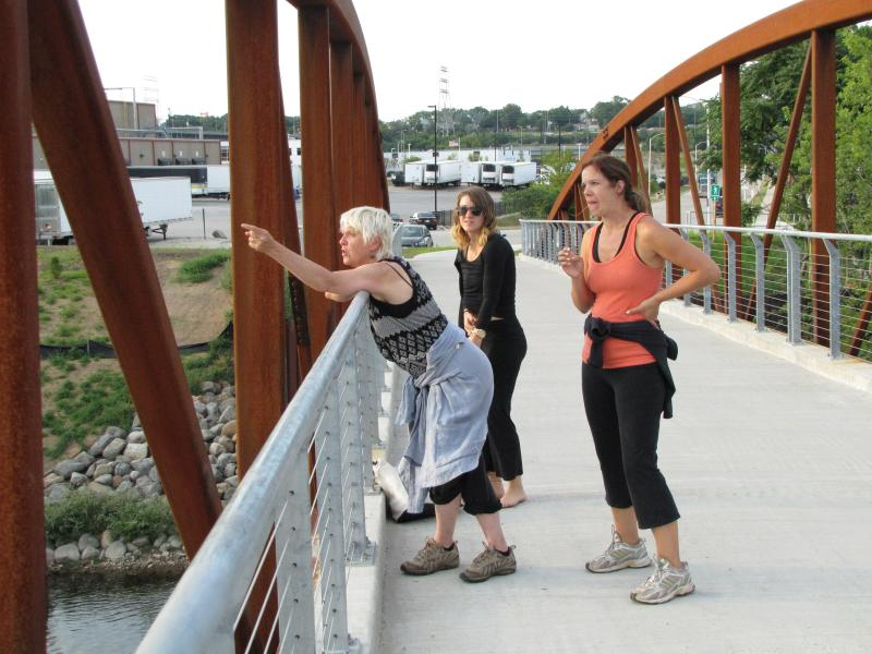 Deb Loewen tweaks performance from Three Bridges Park bridge.