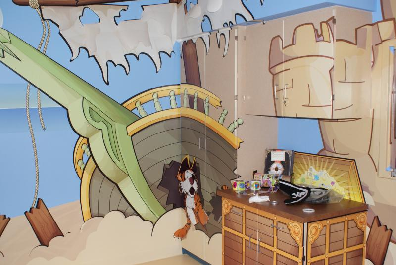 For the Adventure Series imaging machines, scanning rooms are decorated in different themes, like this pirate room.
